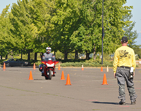 Rider braking with instructor watching