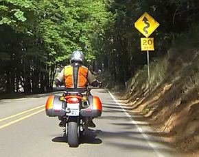 Rider Approaching 20 mph Curve