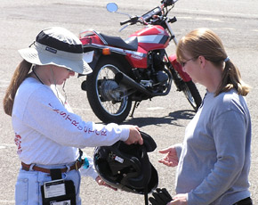 Instructor checking student riding gear