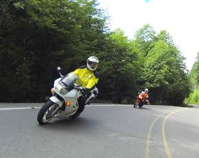 Riders cornering on mountain road